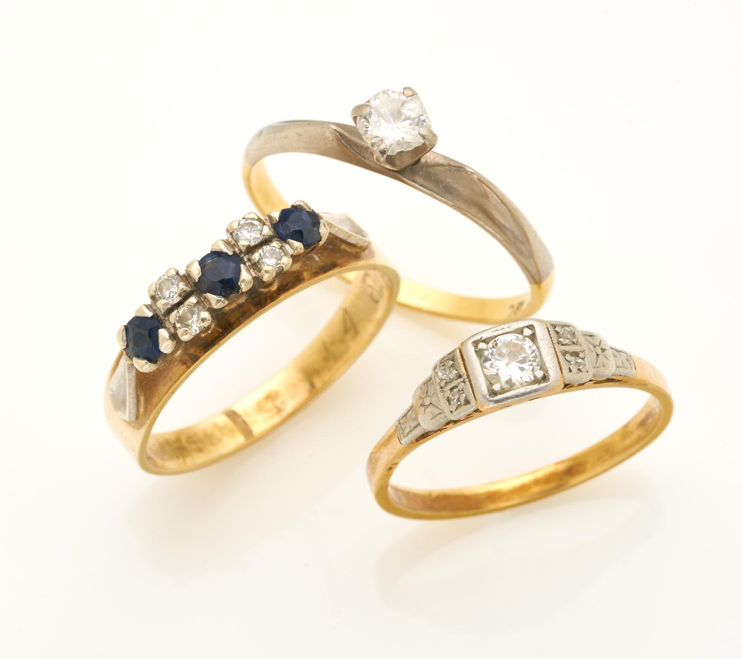 Two solitaire diamond rings and a sapphire and diamond